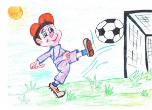 Мальчик забивает гол