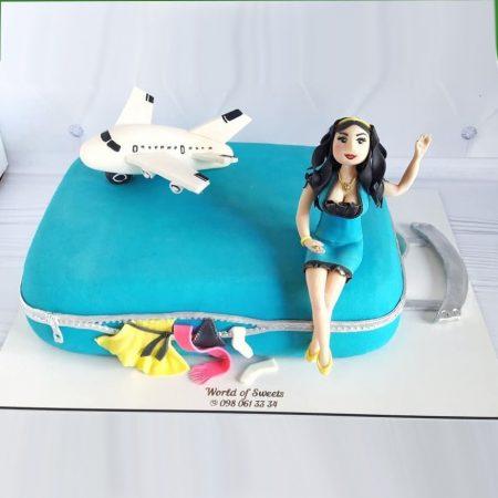 Торт чемодан с фигуркой самолёта и девушки